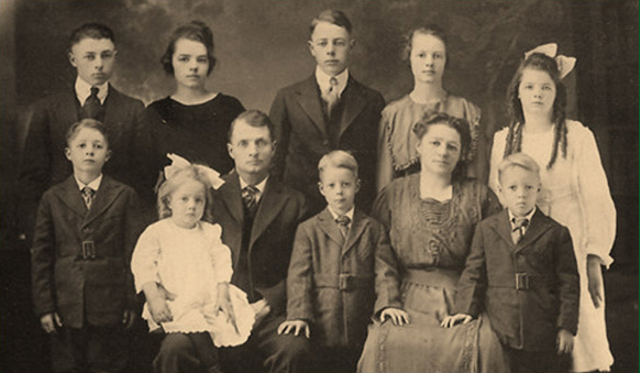 Albert Earl Cranston's family ca 1919 -- L-R back row:  Harold, Margaret, Royal, Helen, Nellie, front row: Ralph, Lillian (May), A.E., Wilbur, Emma and Albert (shared by Kathy Haydon)